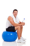 Man fitness ball Royalty Free Stock Photo