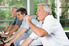 Man in fitness center drinking Royalty Free Stock Image