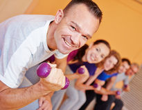 Man in fitness center lifting. Happy best ager men in fitness center lifting dumbbells Stock Image