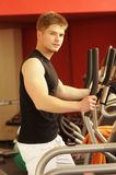 The man in fitness centre Royalty Free Stock Images