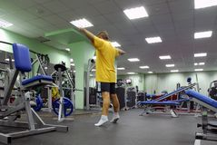 Man in fitness club stock image