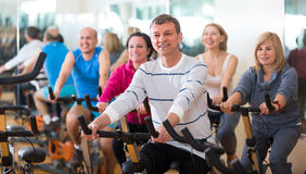 Man on fitness cycle in fitness club Royalty Free Stock Photo