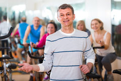 Man on fitness cycle training Stock Images