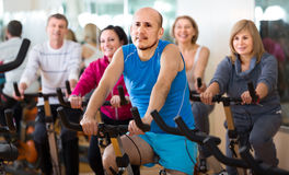 Man on fitness cycle training Stock Photo