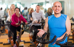 Man on fitness cycle training Stock Photos