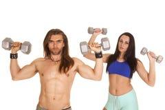 Man fitness flex woman behind flex Stock Photo