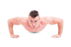 Man fitness instructor making push ups Royalty Free Stock Image