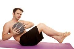 Man fitness medicine ball twist Royalty Free Stock Image