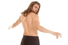 Man fitness no shirt arms out back looking Royalty Free Stock Photos