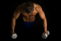 Man fitness no shirt on black pushup high Stock Images
