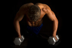 Man fitness no shirt on black pushup show back stock photo