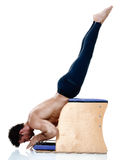 Man fitness pilates exercices isolated Stock Photography