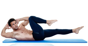 Man fitness pilates exercices isolated Stock Images