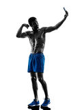 Man fitness pround selfie silhouette Royalty Free Stock Images