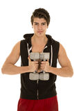 Man fitness weights with vest hold in front. A man in his workout clothes holding on to weights next to his chest Stock Photos