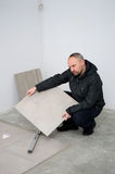 Man fitting floor tiles  Stock Photography
