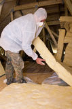 Man fitting roof insulation Royalty Free Stock Photo