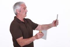 Man fitting tiles Royalty Free Stock Photo