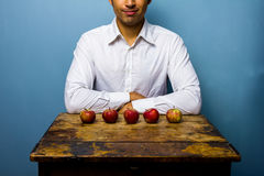 Man with five apples Stock Image