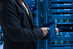 Man fix server network in data center room.  Stock Images
