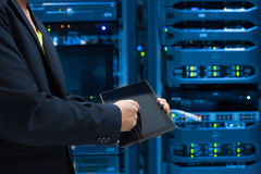 Man fix server network in data center room Royalty Free Stock Photo