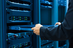 Man fix server network in data center room Stock Photography