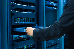 Man fix server network in data center room.  Royalty Free Stock Photo