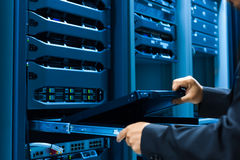 Man fix server network in data center room Royalty Free Stock Images