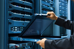 Man fix server network in data center room Royalty Free Stock Image