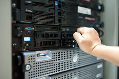 Man fix server network in data center room.  Royalty Free Stock Images