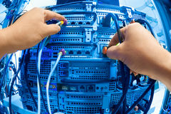 Man fix server network in data center room.  Stock Photos