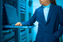 Man fix server network in data center room.  Royalty Free Stock Photography