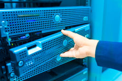 Man fix server network in data center room.  Royalty Free Stock Photos