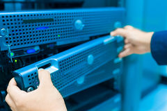 Man fix server network in data center room.  Stock Photo