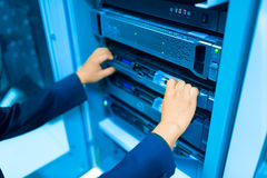 Man fix server network in data center room.  Stock Photography