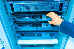 Man fix server network in data center room.  Royalty Free Stock Image
