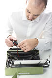 Man fix vintage typewriter Stock Images