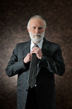 A man fixes his tie Stock Photography