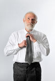 A man fixes his tie Royalty Free Stock Photography