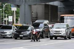 Man fixes a motorbike on street Stock Photography