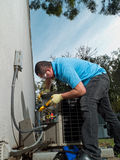 Man fixing. Male hispanic air-conditioning maintenance technician Royalty Free Stock Photo