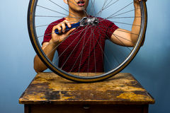 Man fixing bicycle tyre Stock Image