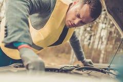 Man fixing broken car Stock Photos