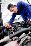 Man fixing a car Stock Photos