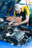 Man fixing a car engine Stock Photos