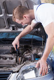Man fixing a car Stock Images