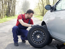 Man fixing a car problem after vehicle breakdown. On the road Royalty Free Stock Images