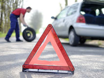 Man fixing a car problem. After vehicle breakdown on the road Royalty Free Stock Photo