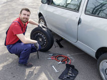 Man fixing a car problem after vehicle breakdown Stock Image