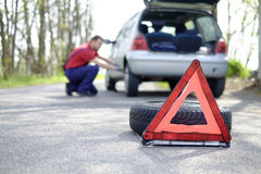 Man fixing a car problem. After vehicle breakdown on the road Stock Photography